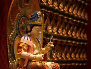 buddha sculpture inside a pagoda