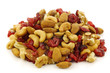 mix of fresh nuts and dried cranberries on a white background