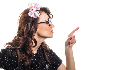 Young woman pointing with her finger something