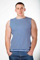 Handsome man on white. Muscular man