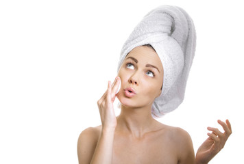 Woman cleaning her face and looking on side