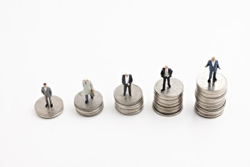 businessmans stand on the money coin white background