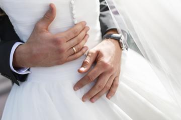 bridegroom embraces his bride