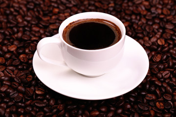 cup of black coffee, and coffee beans around