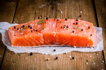 piece of fresh salmon with pepper and sea salt