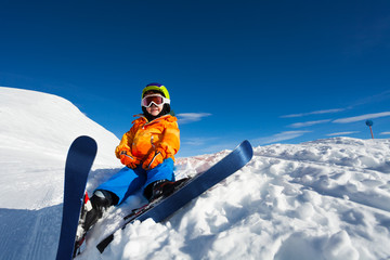Smiling boy wearing ski mask and helmet on snow