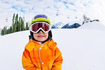 Close-up of smiling boy wearing ski mask in winter