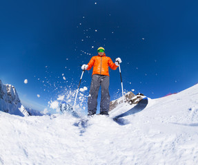 Man with ski mask skiing in action view from below