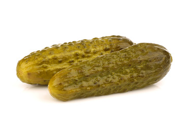 bunch of green pickles on a white background