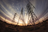 Electricity power pylons at sunset - 78656117