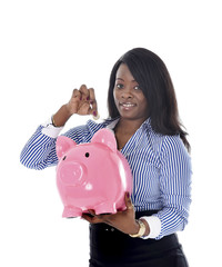 black African business woman putting coin into piggybank