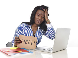 black African American woman in stress at office computer
