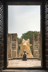 The two Nandi statues seen from inside Gangaikunda Temple.