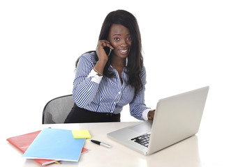 black ethnicity woman working at computer and mobile phone