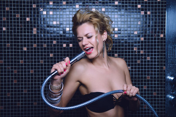 Girl singing in the shower in the bathroom