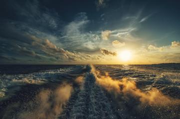 Wake at sunset