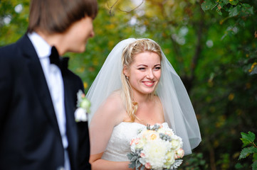 smiling bride groom at a wedding in the summer outdoors