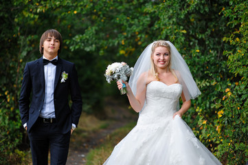 Happy bride and groom at a wedding in the summer outdoors