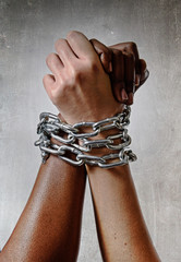 white race chain locked together with black ethnicity hand