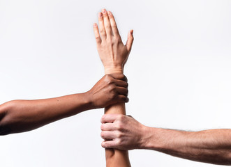 black African hands holding white skin arm in world unity