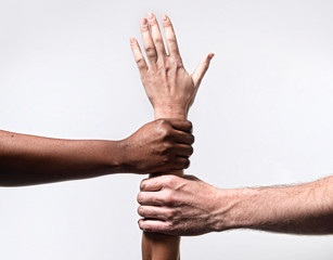 African American and Caucasian hands together world ethnicity