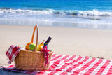 Picnic basket with fruits by the ocean - 78659119