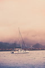Recreational Yacht in fog at the coast of Seychelles