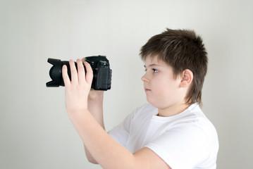 teenage boy with camera on light