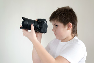 teenage boy with camera on light