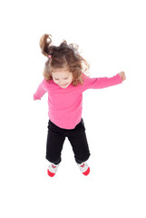 Happy little girl in pink jumping