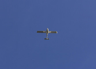 small white plane seen from below