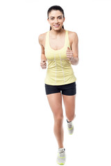 Fitness woman jogging, isolated on white