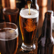 pourng beer from bottle into glass at bar - 78661392