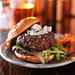 gourmet hamburger with blue cheese with sweet potato fries