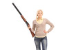 Dangerous girl holding a shotgun
