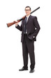 Businessman holding a rifle over his shoulder