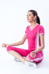 Attractive woman doing yoga exercise