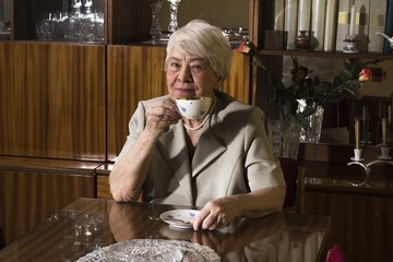 Senior woman sitting at home.