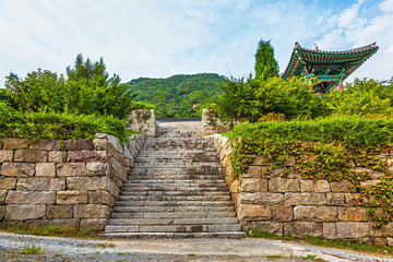 Stone wall with stairs to monk temple