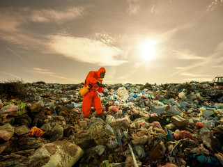 Environmentalist working on waste treatment on the landfill.