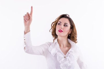 Woman pressing an imaginary button on a white background