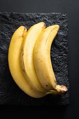 Ripe Bananas on a Black Stone Plate