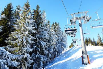The cableway with tourists in Bukovel ski resort, Ukraine