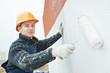 Leinwanddruck Bild - builder facade painter at work