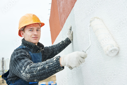 Leinwanddruck Bild builder facade painter at work