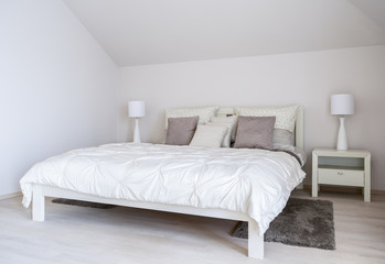 Double bed in a modern bedroom