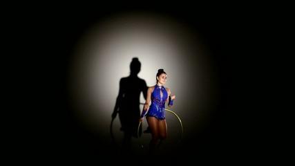 woman exercising Rhythmic Gymnastics hula hoop  in silhouette