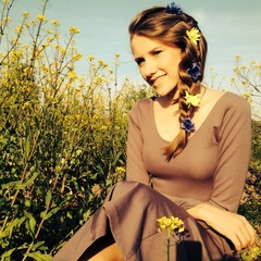 Young smiling girl in rapeseed field