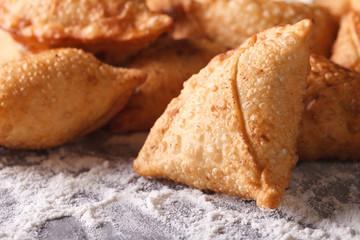 pile of baking samosas macro on the table