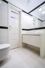 Toilet with washbasin in apartment